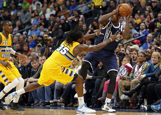 Jan 9, 2014; Denver, CO, USA; Denver Nuggets small forward Kenneth Faried (35) pressures Oklahoma City Thunder power forward Serge Ibaka (9) to keep the ball in bounds in the first quarter at the Pepsi Center. Mandatory Credit: Isaiah J. Downing-USA TODAY Sports