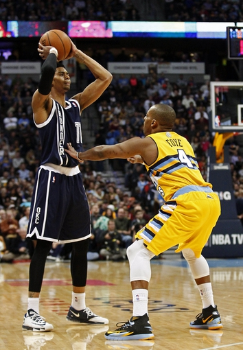 Jan 9, 2014; Denver, CO, USA; Denver Nuggets point guard Randy Foye (4) guards Oklahoma City Thunder shooting guard Jeremy Lamb (11) in the second quarter at the Pepsi Center. Mandatory Credit: Isaiah J. Downing-USA TODAY Sports