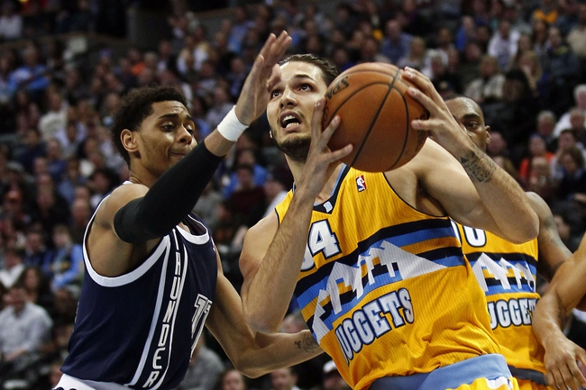 Jan 9, 2014; Denver, CO, USA; Denver Nuggets shooting guard Evan Fournier (94) drives to the net against Oklahoma City Thunder shooting guard Jeremy Lamb (11) in the first quarter at the Pepsi Center. Mandatory Credit: Isaiah J. Downing-USA TODAY Sports