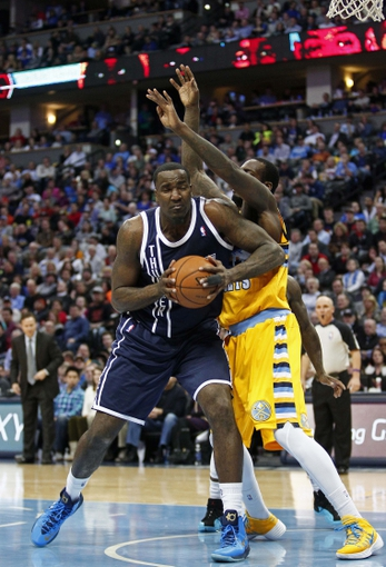 Jan 9, 2014; Denver, CO, USA; Denver Nuggets power forward J.J. Hickson (7) defends against Oklahoma City Thunder center Kendrick Perkins (5) in the second quarter at the Pepsi Center. Mandatory Credit: Isaiah J. Downing-USA TODAY Sports