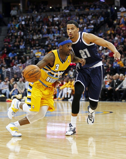 Jan 9, 2014; Denver, CO, USA; Oklahoma City Thunder shooting guard Andre Roberson (21) guards Denver Nuggets point guard Ty Lawson (3) in the fourth quarter at the Pepsi Center. The Nuggets won 101-88. Mandatory Credit: Isaiah J. Downing-USA TODAY Sports