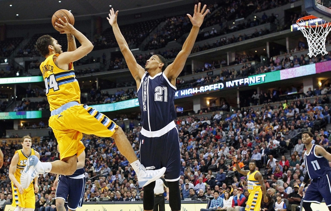 Jan 9, 2014; Denver, CO, USA; Denver Nuggets shooting guard Evan Fournier (94) takes a shot against Oklahoma City Thunder shooting guard Andre Roberson (21) in the fourth quarter at the Pepsi Center. The Nuggets won 101-88. Mandatory Credit: Isaiah J. Downing-USA TODAY Sports