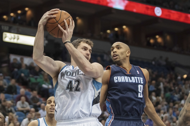 Jan 10, 2014; Minneapolis, MN, USA; Minnesota Timberwolves power forward Kevin Love (42) gets the rebound from Charlotte Bobcats guard Gerald Henderson (9) in the first quarter at Target Center. Mandatory Credit: Brad Rempel-USA TODAY Sports