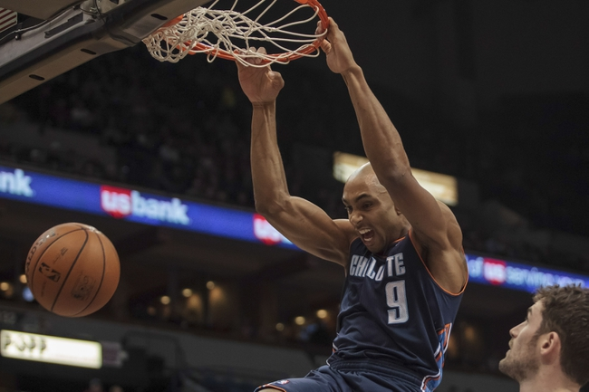 Jan 10, 2014; Minneapolis, MN, USA; Charlotte Bobcats guard Gerald Henderson (9) dunks in the first quarter against the Minnesota Timberwolves at Target Center. Mandatory Credit: Brad Rempel-USA TODAY Sports