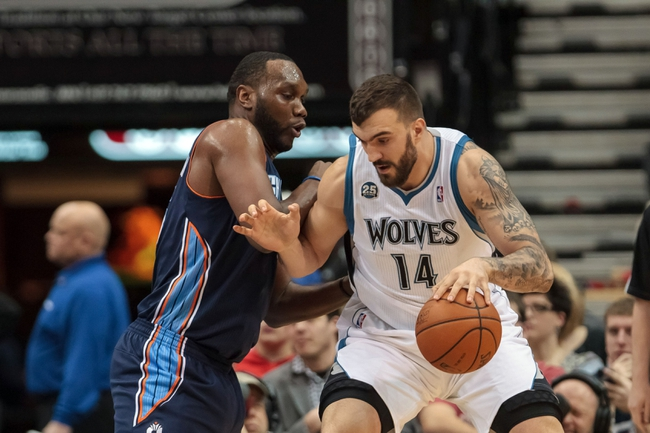Jan 10, 2014; Minneapolis, MN, USA; Minnesota Timberwolves center Nikola Pekovic (14) dribbles into Charlotte Bobcats center Al Jefferson (25) in the first quarter at Target Center. Mandatory Credit: Brad Rempel-USA TODAY Sports