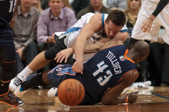 Jan 10, 2014; Minneapolis, MN, USA; Minnesota Timberwolves point guard J.J. Barea (11) collides with Charlotte Bobcats forward Anthony Tolliver (43) in the second quarter at Target Center. Mandatory Credit: Brad Rempel-USA TODAY Sports