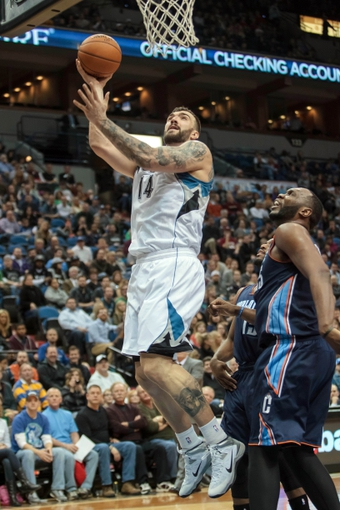 Jan 10, 2014; Minneapolis, MN, USA; Minnesota Timberwolves center Nikola Pekovic (14) shoots in the third quarter against the Charlotte Bobcats at Target Center. Minnesota wins 119-92. Mandatory Credit: Brad Rempel-USA TODAY Sports