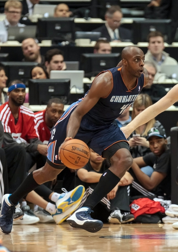 Jan 10, 2014; Minneapolis, MN, USA; Charlotte Bobcats forward Anthony Tolliver (43) dribbles in the fourth quarter against the Minnesota Timberwolves at Target Center. Minnesota wins 119-92. Mandatory Credit: Brad Rempel-USA TODAY Sports