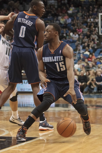 Jan 10, 2014; Minneapolis, MN, USA; Charlotte Bobcats guard Kemba Walker (15) dribbles in the third quarter against the Minnesota Timberwolves at Target Center. Minnesota wins 119-92. Mandatory Credit: Brad Rempel-USA TODAY Sports
