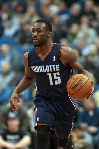 Jan 10, 2014; Minneapolis, MN, USA; Charlotte Bobcats guard Kemba Walker (15) dribbles in the second quarter against the Minnesota Timberwolves at Target Center. Minnesota wins 119-92. Mandatory Credit: Brad Rempel-USA TODAY Sports