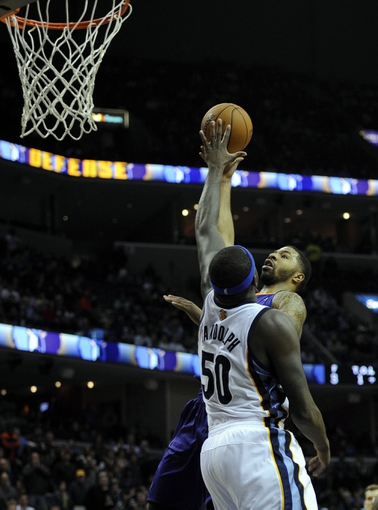 Jan 10, 2014; Memphis, TN, USA; Phoenix Suns power forward Marcus Morris (15) shoots over Memphis Grizzlies power forward Zach Randolph (50) at FedExForum. Memphis Grizzlies beat the Phoenix Suns 104 - 99. Mandatory Credit: Justin Ford-USA