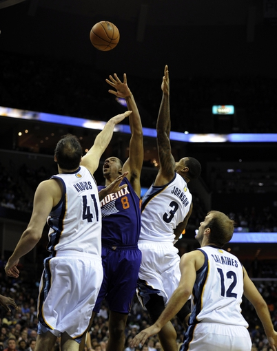 Jan 10, 2014; Memphis, TN, USA; Phoenix Suns power forward Channing Frye (8) shoots over Memphis Grizzlies center Kosta Koufos (41) and Memphis Grizzlies power forward James Johnson (3) during the fourth quarter at FedExForum. Memphis Grizzlies beat the Phoenix Suns 104 - 99. Mandatory Credit: Justin Ford-USA TODAY Sports