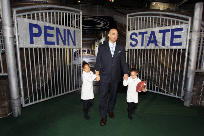 Jan 11, 2014; State College, PA, USA; New Penn State head coach James Franklin walks onto the field with daughters Shola Franklin (left) and Addison Franklin (right) after James Franklin is announced as the Penn State Nittany Lions new head coach during a press conference at Beaver Stadium. Mandatory Credit: Matthew O'Haren-USA TODAY Sports
