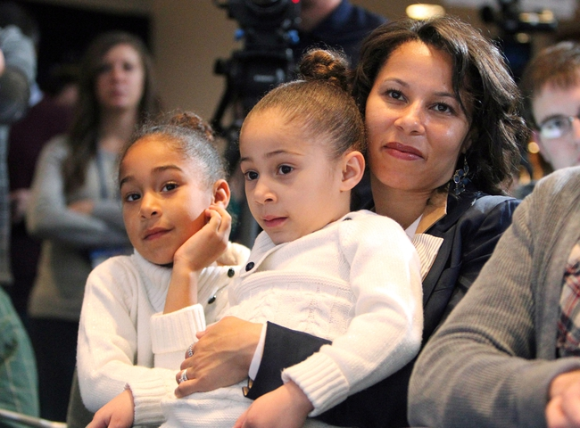 Jan 11, 2014; State College, PA, USA; Fumi Franklin (right) along with daughters Addison Franklin (middle) and Shola Franklin (left) look on as James Franklin is announced as the Penn State Nittany Lions new head coach during a press conference at Beaver Stadium. Mandatory Credit: Matthew O'Haren-USA TODAY Sports