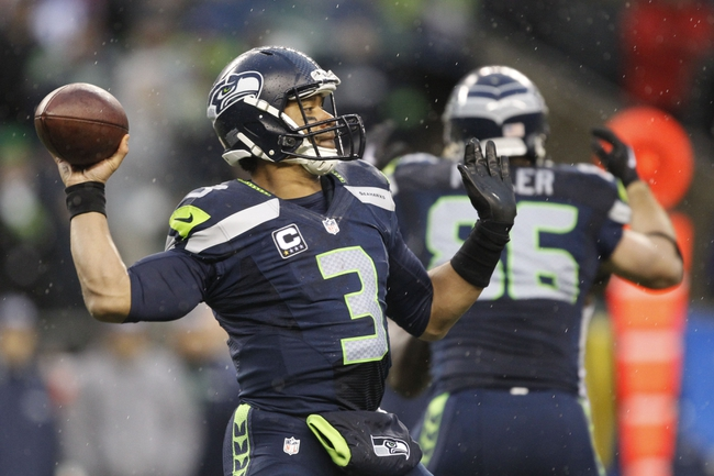 Jan 11, 2014; Seattle, WA, USA; Seattle Seahawks quarterback Russell Wilson (3) passes the football against the New Orleans Saints during the second half of the 2013 NFC divisional playoff football game at CenturyLink Field. Mandatory Credit: Joe Nicholson-USA TODAY Sports