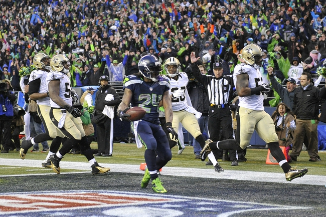 Jan 11, 2014; Seattle, WA, USA; Seattle Seahawks running back Marshawn Lynch (24) scores a touchdown against the New Orleans Saints during the second half of the 2013 NFC divisional playoff football game at CenturyLink Field. Mandatory Credit: Steven Bisig-USA TODAY Sports
