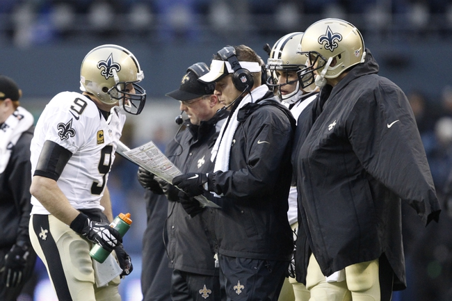 Jan 11, 2014; Seattle, WA, USA; New Orleans Saints quarterback Drew Brees (9) talks to head coach Sean Payton (white visor) against the Seattle Seahawks during the second half of the 2013 NFC divisional playoff football game at CenturyLink Field. Mandatory Credit: Joe Nicholson-USA TODAY Sports