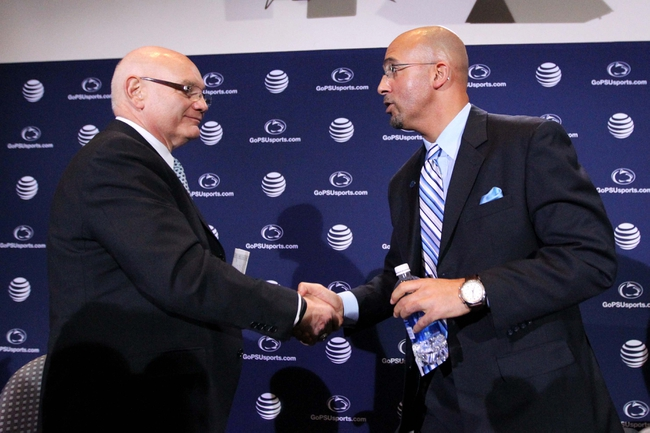 Jan 11, 2014; State College, PA, USA; James Franklin (right) shakes hands with Penn State University Athletic Director David Joyner (left) after James Franklin is announced as the Penn State Nittany Lions new head coach during a press conference at Beaver Stadium. Mandatory Credit: Matthew O'Haren-USA TODAY Sports
