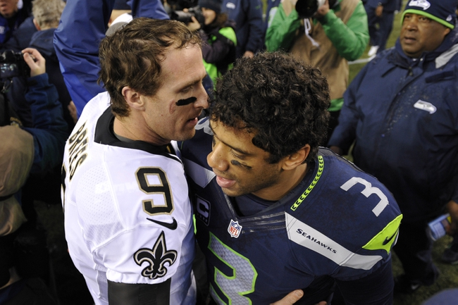 Jan 11, 2014; Seattle, WA, USA; New Orleans Saints quarterback Drew Brees (9) shakes hands with Seattle Seahawks quarterback Russell Wilson (3) after the 2013 NFC divisional playoff football game at CenturyLink Field. The Seahawks defeated the Saints 23-15. Mandatory Credit: Steven Bisig-USA TODAY Sports