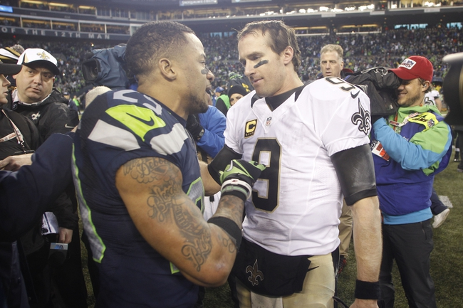 Jan 11, 2014; Seattle, WA, USA; New Orleans Saints quarterback Drew Brees (9) shakes hands with Seattle Seahawks free safety Earl Thomas (29) after the 2013 NFC divisional playoff football game at CenturyLink Field. The Seahawks defeated the Saints 23-15. Mandatory Credit: Joe Nicholson-USA TODAY Sports