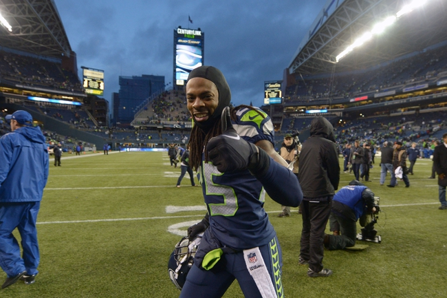 Jan 11, 2014; Seattle, WA, USA; Seattle Seahawks cornerback Richard Sherman (25) celebrates after the 2013 NFC divisional playoff football game against the New Orleans Saints at CenturyLink Field. The Seahawks defeated the Saints 23-15. Mandatory Credit: Kirby Lee-USA TODAY Sports