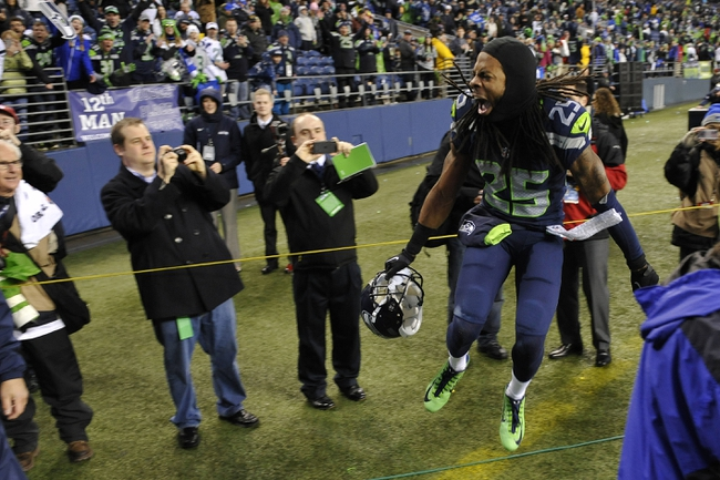 Jan 11, 2014; Seattle, WA, USA; Seattle Seahawks cornerback Richard Sherman (25) celebrates after the 2013 NFC divisional playoff football game against the New Orleans Saints at CenturyLink Field. The Seahawks defeated the Saints 23-15. Mandatory Credit: Steven Bisig-USA TODAY Sports