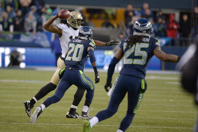 Jan 11, 2014; Seattle, WA, USA; New Orleans Saints wide receiver Marques Colston (12) throws an illegal forward pass against Seattle Seahawks cornerback Jeremy Lane (20) and cornerback Richard Sherman (25) during the second half of the 2013 NFC divisional playoff football game at CenturyLink Field. The Seahawks defeated the Saints 23-15. Mandatory Credit: Kirby Lee-USA TODAY Sports