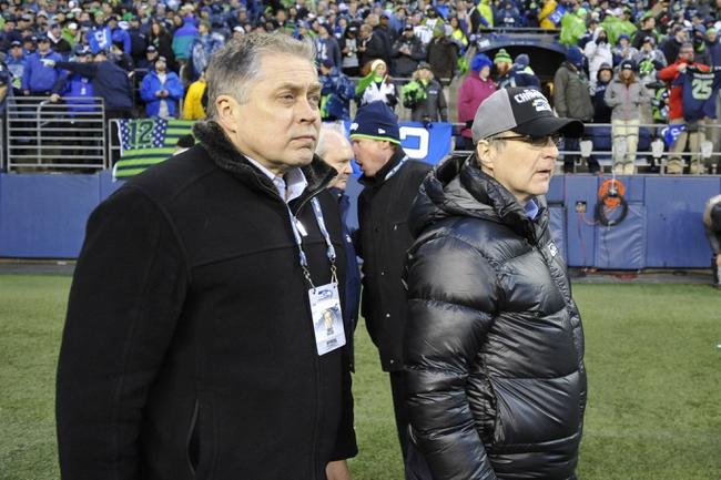 Jan 11, 2014; Seattle, WA, USA; Bert Kolde (left) and Seattle Seahawks owner Paul Allen (right) walks on the field after the 2013 NFC divisional playoff football game against the New Orleans Saints at CenturyLink Field. The Seahawks defeated the Saints 23-15. Mandatory Credit: Steven Bisig-USA TODAY Sports