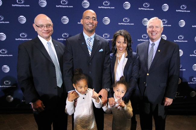 Jan 11, 2014; State College, PA, USA; Penn State University Athletic Director David Joyner (left) James Franklin (second from left) with daughter Shola Franklin and wife Fumi Franklin (second from right) with daughter Addison Franklin and Penn State University President Rodney Erickson (right) pose for a photo as James Franklin is announced as the Penn State Nittany Lions new head coach during a press conference at Beaver Stadium. Mandatory Credit: Matthew O'Haren-USA TODAY Sports