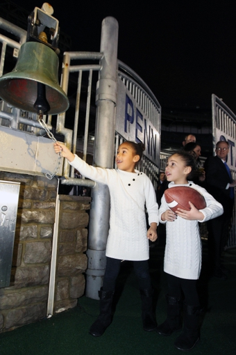Jan 11, 2014; State College, PA, USA; Shola Franklin (left) and Addison Franklin (right) ring the victory bell after their father James Franklin is announced as the Penn State Nittany Lions new head coach during a press conference at Beaver Stadium. Mandatory Credit: Matthew O'Haren-USA TODAY Sports