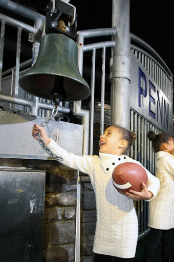 Jan 11, 2014; State College, PA, USA; Addison Franklin rings the victory bell after her father James Franklin is announced as the Penn State Nittany Lions new head coach during a press conference at Beaver Stadium. Mandatory Credit: Matthew O'Haren-USA TODAY Sports