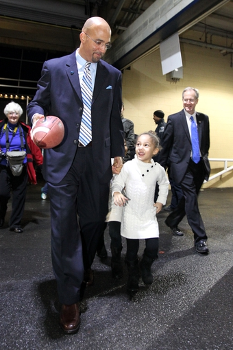 Jan 11, 2014; State College, PA, USA; James Franklin walks with his daughter Addison Franklin after James Franklin is announced as the Penn State Nittany Lions new head coach during a press conference at Beaver Stadium. Mandatory Credit: Matthew O'Haren-USA TODAY Sports