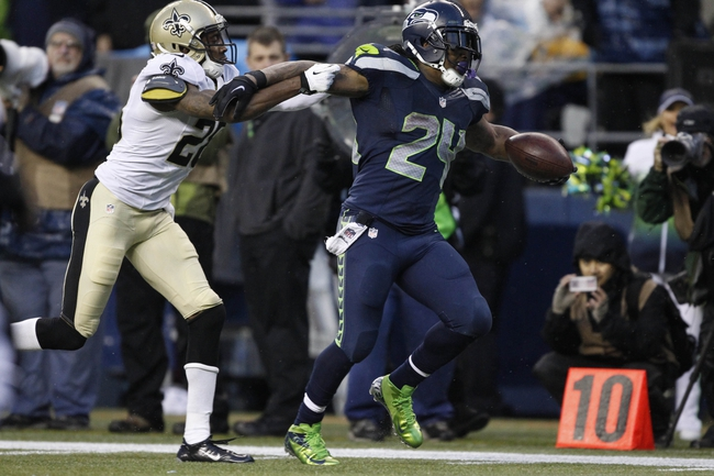 Jan 11, 2014; Seattle, WA, USA; Seattle Seahawks running back Marshawn Lynch (24) scores a touchdown against New Orleans Saints cornerback Keenan Lewis (28) during the second half of the 2013 NFC divisional playoff football game at CenturyLink Field. The Seahawks defeated the Saints 23-15. Mandatory Credit: Joe Nicholson-USA TODAY Sports