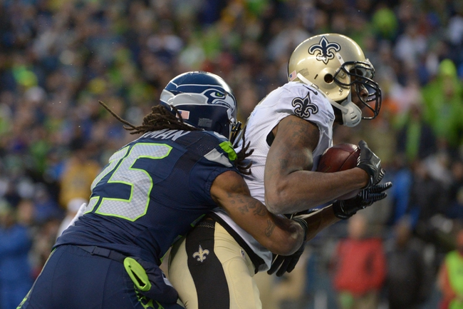Jan 11, 2014; Seattle, WA, USA; New Orleans Saints wide receiver Marques Colston (right) catches a pass in front of Seattle Seahawks cornerback Richard Sherman (25) during the second half of the 2013 NFC divisional playoff football game at CenturyLink Field. The Seahawks defeated the Saints 23-15. Mandatory Credit: Kirby Lee-USA TODAY Sports
