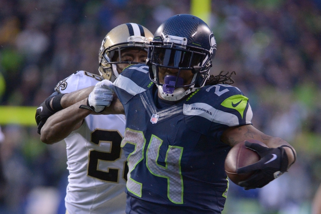 Jan 11, 2014; Seattle, WA, USA; Seattle Seahawks running back Marshawn Lynch (24) scores a touchdown in front of New Orleans Saints running back Khiry Robinson (29) during the second half of the 2013 NFC divisional playoff football game at CenturyLink Field. Mandatory Credit: Kirby Lee-USA TODAY Sports