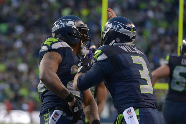 Jan 11, 2014; Seattle, WA, USA; Seattle Seahawks running back Marshawn Lynch (left) celebrates with quarterback Russell Wilson (3) after scoring a touchdown against the New Orleans Saints during the second half of the 2013 NFC divisional playoff football game at CenturyLink Field. Mandatory Credit: Kirby Lee-USA TODAY Sports