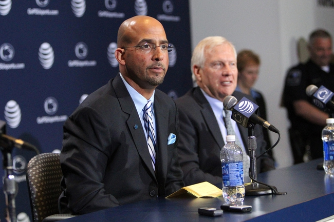 Jan 11, 2014; State College, PA, USA; James Franklin (left) answers questions from the media as university president Rodney Erickson (right) looks on as James Franklin is announced as the Penn State Nittany Lions new head coach during a press conference at Beaver Stadium. Mandatory Credit: Matthew O'Haren-USA TODAY Sports