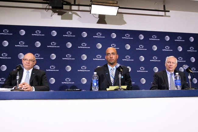 Jan 11, 2014; State College, PA, USA; Penn State athletic director David Joyner (left) , new head coach James Franklin (center) and university president Rodney Erickson (right) answer questions from the media as James Franklin is announced as the Penn State Nittany Lions new head coach during a press conference at Beaver Stadium. Mandatory Credit: Matthew O'Haren-USA TODAY Sports