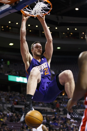 Jan 11, 2014; Auburn Hills, MI, USA; Phoenix Suns center Miles Plumlee (22) dunks in the first half against the Detroit Pistons at The Palace of Auburn Hills. Mandatory Credit: Rick Osentoski-USA TODAY Sports