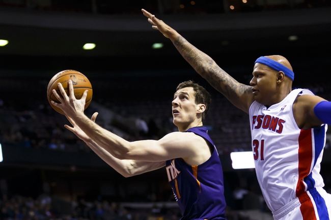 Jan 11, 2014; Auburn Hills, MI, USA; Phoenix Suns shooting guard Goran Dragic (1) goes to the basket on Detroit Pistons power forward Charlie Villanueva (31) in the first half at The Palace of Auburn Hills. Mandatory Credit: Rick Osentoski-USA TODAY Sports