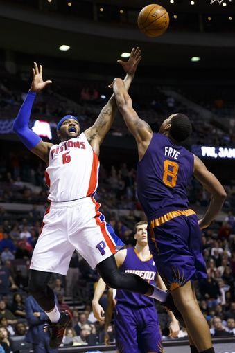 Jan 11, 2014; Auburn Hills, MI, USA; Detroit Pistons small forward Josh Smith (6) shoots over Phoenix Suns power forward Channing Frye (8) in the fourth quarter at The Palace of Auburn Hills. Detroit won 110-108. Mandatory Credit: Rick Osentoski-USA TODAY Sports