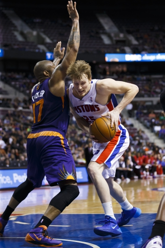 Jan 11, 2014; Auburn Hills, MI, USA; Detroit Pistons small forward Kyle Singler (25) moves the ball on Phoenix Suns small forward P.J. Tucker (17) in the fourth quarter at The Palace of Auburn Hills. Detroit won 110-108. Mandatory Credit: Rick Osentoski-USA TODAY Sports