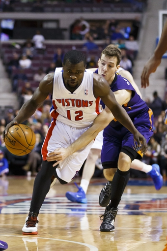 Jan 11, 2014; Auburn Hills, MI, USA; Detroit Pistons point guard Will Bynum (12) moves the ball defended by Phoenix Suns shooting guard Goran Dragic (1) in the fourth quarter at The Palace of Auburn Hills. Detroit won 110-108. Mandatory Credit: Rick Osentoski-USA TODAY Sports