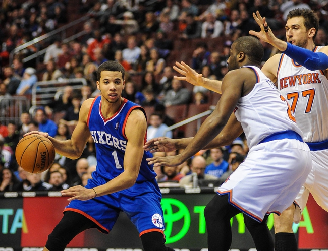 Jan 11, 2014; Philadelphia, PA, USA; Philadelphia 76ers point guard Michael Carter-Williams (1) looks to pass the ball during the game against the New York Knicks at the Wells Fargo Center. The New York Knicks won 102-92.Mandatory Credit: John Geliebter-USA TODAY Sports