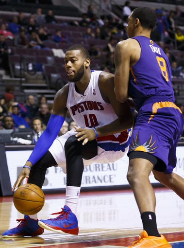 Jan 11, 2014; Auburn Hills, MI, USA; Detroit Pistons power forward Greg Monroe (10) controls the ball while defended by Phoenix Suns power forward Channing Frye (8) in the third quarter at The Palace of Auburn Hills. Detroit won 110-108. Mandatory Credit: Rick Osentoski-USA TODAY Sports