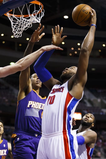 Jan 11, 2014; Auburn Hills, MI, USA; Detroit Pistons power forward Greg Monroe (10) shoots on Phoenix Suns power forward Channing Frye (8) in the third quarter at The Palace of Auburn Hills. Detroit won 110-108. Mandatory Credit: Rick Osentoski-USA TODAY Sports