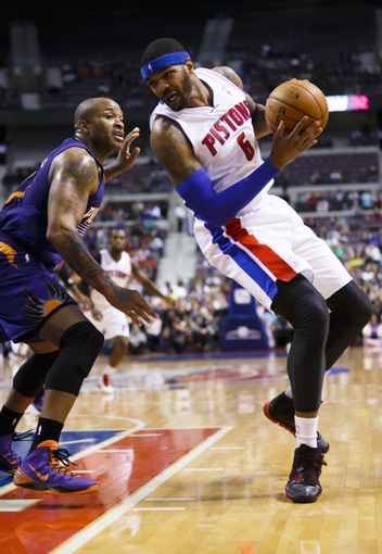 Jan 11, 2014; Auburn Hills, MI, USA; Detroit Pistons small forward Josh Smith (6) is defended by Phoenix Suns small forward P.J. Tucker (17) in the fourth quarter at The Palace of Auburn Hills. Detroit won 110-108. Mandatory Credit: Rick Osentoski-USA TODAY Sports