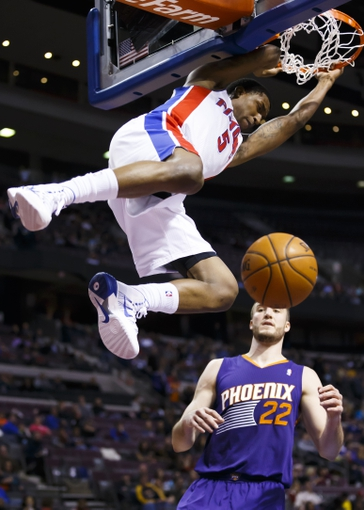 Jan 11, 2014; Auburn Hills, MI, USA; Detroit Pistons shooting guard Kentavious Caldwell-Pope (5) dunks on Phoenix Suns center Miles Plumlee (22) in the third quarter at The Palace of Auburn Hills. Detroit won 110-108. Mandatory Credit: Rick Osentoski-USA TODAY Sports