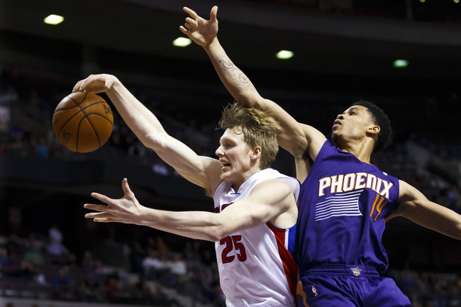 Jan 11, 2014; Auburn Hills, MI, USA; Detroit Pistons small forward Kyle Singler (25) grabs the rebound over Phoenix Suns shooting guard Gerald Green (14) in the fourth quarter at The Palace of Auburn Hills. Detroit won 110-108. Mandatory Credit: Rick Osentoski-USA TODAY Sports