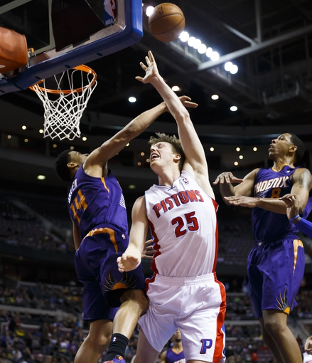 Jan 11, 2014; Auburn Hills, MI, USA; Phoenix Suns shooting guard Gerald Green (14) blocks a shot by Detroit Pistons small forward Kyle Singler (25) in the third quarter at The Palace of Auburn Hills. Detroit won 110-108. Mandatory Credit: Rick Osentoski-USA TODAY Sports